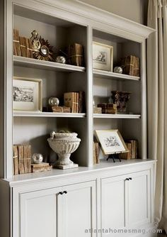 Arrangement of vintage, neutral colored items on shelves / hutch. Annie Sloan chalk painted hutch.