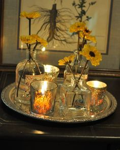 This looks easy.  Maybe with dark blue votive glasses and yellow roses or daisies?
