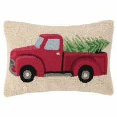 "Hand-hooked wool and cotton pillow with a holiday truck motif.  Product: PillowConstruction Material: Wool, cotton cover and polyester fillColor: Cream and redFeatures:  Insert includedHand-hooked Dimensions: 12"" x 18"""