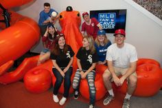 Chicago White Sox Cave Crasher Lisa Loher and her guest Patricia Loher pose on the Nonopus with the MLB Fan Cave Dwellers during a visit to the MLB Fan Cave Tuesday, September 3, 2013, at Broadway and 4th Street in New York City. (Photo by Thomas Levinson/MLB Photos via Getty Images)
