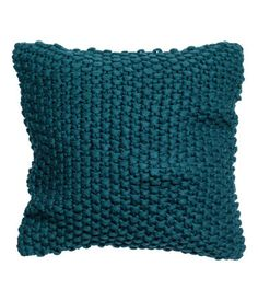 Moss-knit cushion cover with woven backing and concealed zip.