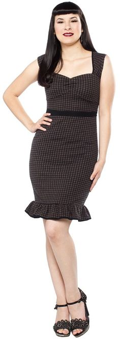 SOURPUSS DARK HOUNDSTOOTH WIGGLE DRESS - Gals Put a little wiggle in your walk in the new Dark Houndstooth Wiggle Dress!! This soft, sweater-like outer shell is stretchy and form fitting, while the inner lining is silky smooth. Comes with a removable black flower pin. $49.00