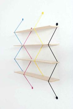 Polish designer Bashko Trybek created 'serpent', a modular shelving system that uses four vivid zigzagging wires as support its wooden planks. since each piece stands alone, the structure becomes adjustable, allowing users to decide on the le