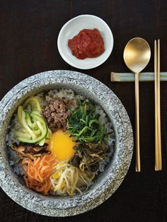 I had Bibimbap recently and I have been waiting to find a recipe I can make! this looks perfect!!    Skillet Rice (Bibimbap) from CookingChannelTV.com