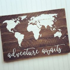 This is the perfect sign for your little ones nursery or to map your adventures! The world map along with Adventure Awaits is painted on a reclaimed pallet wood sign. Both the map and lettering are white. Board is lightly stained and sanded around the edges for a more rustic appearance. Sign measures 26 wide x 18 tall and comes ready to hang