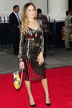 Sarah Jessica Parker carrying a 3D effect sequin Baguette from the Spring/Summer 2013 collection in London.  Photo credit: StarTraks Photo/FENDI