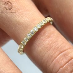 Take a closer look at this dainty round brilliant cut diamond eternity band and you will see the fine craftsmanship and attention to detail.