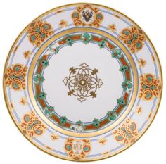 TWO PLATES FROM THE SERVICE OF GRAND DUKE KONSTANTIN NIKOLAEVICH, IMPERIAL PORCELAIN MANUFACTORY, ST PETERSBURG, PERIOD OF NICHOLAS I (1825-1855), 1848  both with cavetto centred with a stylised gilded flowerhead, the borders with emerald green, gilt, brick red and black strapwork ornament, relieved by medallions with the Imperial double-headed eagle and the Grand Duke's cipher, with blue Imperial cipher of Nicholas I  diameter 23.5cm
