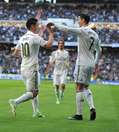 James Rodriguez of Real Madrid celebrates with Cristiano Ronaldo after scoring Real's opening goal during the La Liga match between Real Madrid CF and RCD Espanyol at Estadio Santiago Bernabeu on January 10, 2015 in Madrid, Spain.