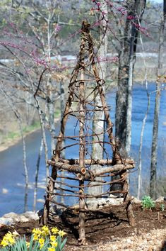 PULL SOME GRAPE VINES FROM OUR WOODS & DO THIS! Every garden needs a trellis. Upcycled Garden Trellis
