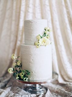 A spackled texture gives this white-wedding cake some serious minimalist flair.