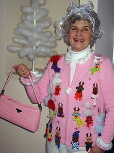 """This is """"pure"""" Christmas sweater! Worn without irony or jaded cynicism, this Pepto-Bismol-colored nightmare represents the true meaning of Christmas sweater; an artistic masterpiece created with lots of love and yarn! This old dear is keeping it real, son! So you need to give her your respect and admiration, right now, you hipster sweater wannabe! - See more at: http://blog.nextdayflyers.com/top-10-best-of-the-worst-christmas-sweaters/"""