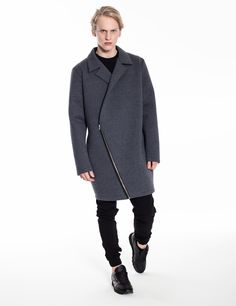 Model is wearing: grey, neoprene ORIGAMI coat & black Universum sweatpants