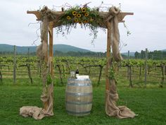 Decorated Wedding Arch with Burlap and Sunflowers.  Perfect for a country wedding.  Designed by Colonial Florist, Gordonsville, VA.