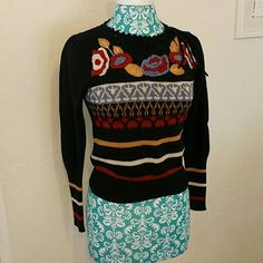 Vintage Embroidered Sweater Gorgeous sweater!  Super flattering. Beautifully embroidered. Acrylic Nylon blend. This item is also available at Antiques and Things, 4710 Central Ave SE, Albuquerque, NM 87108, Booth #19. As a result please allow a few days for shipping College Town Sweaters Crew & Scoop Necks