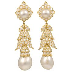 "Van Cleef & Arpels Pearl Diamond Drop Earrings. This is a one of a kind pair of earrings. Made in 1969 by Van Cleef and Arpels. These are made for day and night, as the bottoms are detachable. There is an estimated total diamond weight of 12.00cts E-F color, VS clarity. The round upper pearls measure 9.9mm each, and the baroque lower pearls measure 14.7mm and 14.8mm.  Signed "" 1969 Van Cleef & Arpels N.Y. 40923"""