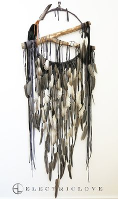 Hawkwind Series - 18″ ring Atlantis in Dusk Brown and Charcoal Grey with Natural Feathers, Hand Carved Branch & Quartz Crystal