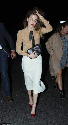 Effortless elegance: Amber Heard sported a chic two-piece as she headed to Ceviche Soho with a group of pals on Sunday, before finishing the evening with a drink in The Haggerston pub in Dalston