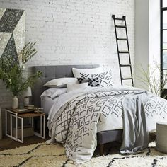 Neutral bedroom scheme: Set a contemporary tone with a bold diamond print that combines Scandi and Moroccan influences. Team it with white, pearlescent and grey accessories for a sophisticated look. (Photo: West Elm). Find more bedroom decorating ideas at housebeautiful.co.uk
