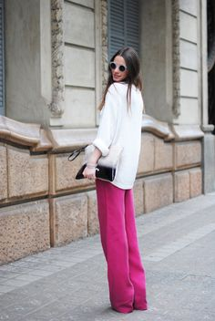 wide-legged fuchsia pants.