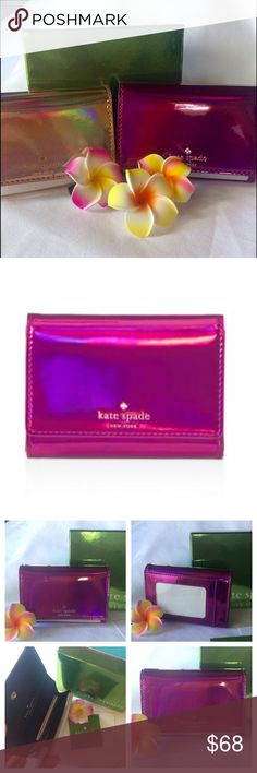 Kate Spade Darla metallic wallet in Baja Rose Kate Spade New York Rainer Lane Darla metallic wallet in Baja Rose.  Gleaming, hologram-effect finish.  Coated canvas, snap closure.  interior zip pocket with a separate slip pocket, attached key ring pocket, exterior  ID window and separate slip pocket.  🚫Trades. kate spade Bags Wallets