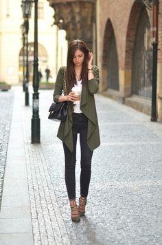 Simple but still dressed up: Green blazer, white tee, black jeans with green heels