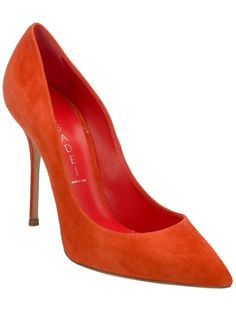 Burnt orange suede pump from Casadei featuring a pointed toe, a leather sole and a stiletto heel.