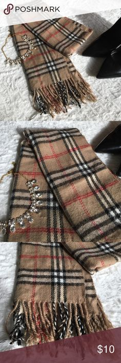 "Burberry-Style Scarf ‼️ Not Authentic Burberry ‼️ This is a Burberry-style scarf. Has been worn but it's in great condition. No stains or tears. Approximately 64"" long.   🛍 Bundle & Save: 20% off 2+ items!  🙅🏻 No trades / selling off Posh.  ✔️ Reasonable offers always welcome. Accessories Scarves & Wraps"