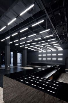 Image 32 of 49 from gallery of Shanghai Museum of Glass Park / Coordination Asia. Courtesy of Coordination Asia Ltd. Club Design, Gym Design, Garage Design, Gym Lighting, Interior Lighting, Garage Interior, Office Interior Design, Lighting Concepts, Lighting Design