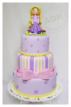 Abby likes this cake - but wants Ariel, Cinderella and Belle????