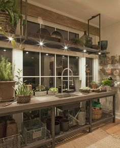 wonderful idea for utilizing a sunroom or a potting shed wall or greenhouse wall, love the scaffold type shelving! Potting room by Kevin Knight & Co. Outdoor Spaces, Outdoor Living, Utility Room Designs, Flower Room, Potting Sheds, Potting Benches, Deco Design, Lamp Design, Home And Deco