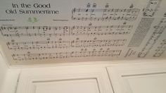 Using homemade mod podge, favorite hymns and sheet music were used for covering the ceiling, adding whimsy and  inspiration