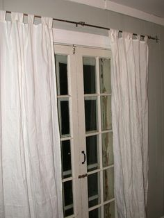 Another curtain for French doors. Like the positioning, but remember to pick fabric with good drape to avoid this wrinkled look.