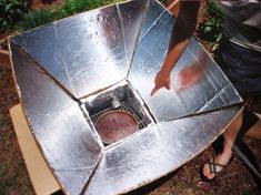 This design produces a powerful solar cooker — 350° or more. It can be made for only a few dollars, using ordinary household materials and tools, and is also a great project for older children.