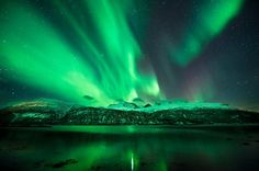 Shocking Display   Brilliant curtains of light shimmer over Norwegian mountains on February 14—part of a recent spate of auroras that caught sky-watchers by surprise. because the displays weren't linked to specific eruptions from the sun.