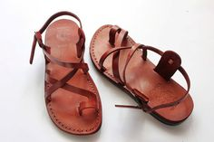 New camel Brand Jesus sandals for woman ,round toe sandals from Jerusalem .  It is just a comfort fit ,and made to wear daily for a long time .  Made from genuine caw leather .  These  Jerusalem sandals are made to serve for long time .  Made from a natural leather in dark brown color which is the natural color of the skin .  The leather is fresh thick and having a very good finish no trash leather or sews .  And this is the original branded sandals from the local Jerusalem sandals .  made…