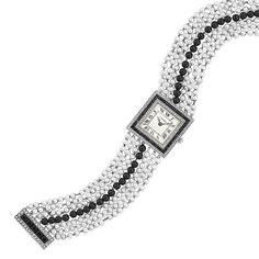 Love the pearl strands on this Cartier bracelet/watch. Art Deco Diamond, Black Onyx, and Pearl Bracelet-Watch / c. 1920 / via Doyle New York