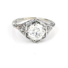 Art Deco platinum and diamond engagement ring, circa 1940, 2.01ct Old European-cut diamond, color G-H, clarity VS1 accented by two small diamonds in filigree setting, size 7