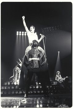 Freddie Mercury (riding Darth Vader)