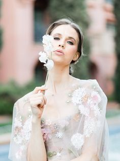 65d1d658 Bride wearing Marchesa couture Spring 2018 collection blush floral gown  with white sweet pea flower,