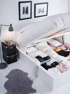 Instead of sliding crates or boxes underneath that peek through your bed skirt, use a storage savvy platform that sits under your mattress.