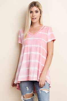 """Our """"Away We Go"""" Knit Top is to-dye for! Not only is this top cozy and soft, but it's super fun for the warm-weather seasons. Features a pre-washed tie dye print, cut outs at the neckline, and an asymmetrical hemline. This top will leave you feeling comfortable all day long! Material: 95% Polyester, 5% Spandex Size Suggestion: S(0/4) M(6/8) L(10/12) Model is 5'10, wearing a small. Fit: Oversized"""