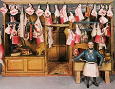 "This grisly 1840 doll-sized butcher shop with miniature animal carcasses and a floor covered in sawdust and blood would be shockingly graphic to our modern sensibilities.  (An 1840 model butcher shop, pictured in ""The World of Toys,"" even depicts the blood and sawdust on the floor.)"