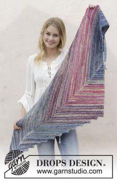 Оригинальная модель шали необычной формы, связанной из тонкой пряжи на основе шерсти. Для вязания потребуется 4 мотка пряжи разных цветов