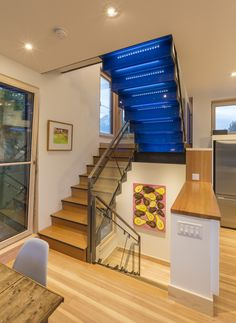 SmallHouseBliss —>> Triple-paned European designed and manufactured windows (love the way they open in from the top like this, as well as swinging in from one side or the other. Europeans are eating US manufacturers lunch over forward thinking energy-efficient designs like these! The Butcherknife Residence, an artist's modern energy-efficient home with 2 bedrooms + art studio in 1200 sqft. | www.facebook.com/SmallHouseBliss