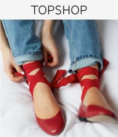 Embrace the full ballerina look in these red pumps with pretty ankle tie detail.