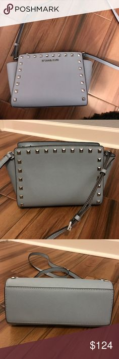 """SELMA MEDIUM STUDDED LEATHER MESSENGER -100% Cow Leather  -Gold-Tone Hardware  -11.5""""W X 6.7""""H X 4.3""""D  -Adjustable Strap: 21.5""""-23.5"""" -Interior: One Zip Pocket  -Lining: 100% Polyester  -Imported  -Gently used Michael Kors Bags Crossbody Bags"""