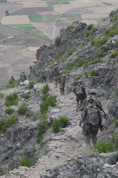 U.S. Army Soldiers assigned to Company A, No Slack Battalion 2/327 (Official), 1st Brigade Combat Team, 101st Airborne Division, accompany U.S. Army Col. J.P. McGee, brigade commander, during a dismounted patrol through the Pech Valley near Combat Outpost Honaker-Miracle, Kunar Province, Afghanistan. (U.S. Army photo by Spc. Vang Seng Thao)