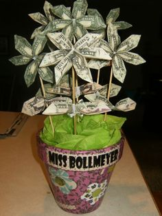 Money Flower Bouquet. So easy! Flower folding instructions at: http://www.homemade-gifts-made-easy.com/origami-money-flowers.html