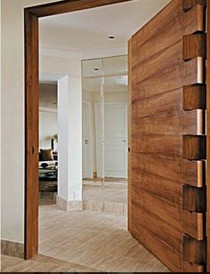I love custom made doors. This is an amazing piece. Check out the hinges, a work of art.